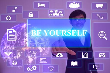 egoistic: BE YOURSELF concept  presented by  businessman touching on  virtual  screen Stock Photo