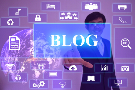 BLOG concept  presented by  businessman touching on  virtual  screen Stock Photo