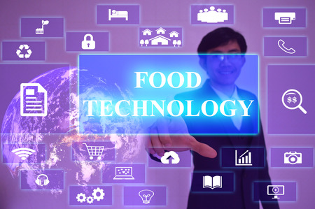 ehec: FOOD TECHNOLOGY concept  presented by  businessman touching on  virtual  screen