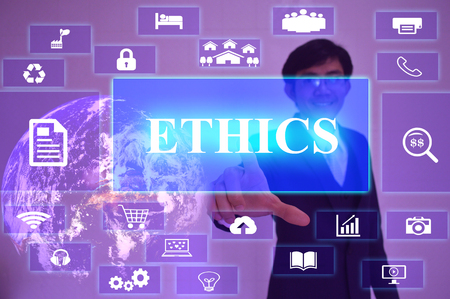 normative: ETHICS concept  presented by  businessman touching on  virtual  screen Stock Photo