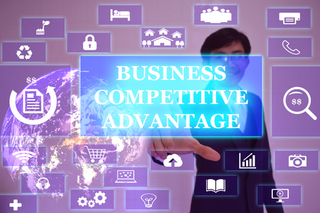 differentiation: BUSINESS COMPETITIVE ADVANTAGE concept  presented by  businessman touching on  virtual  screen