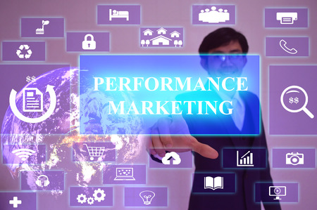 emarketing: PERFORMANCE  MARKETING concept  presented by  businessman touching on  virtual  screen