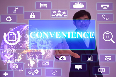 CONVENIENCE  concept  presented by  businessman touching on  virtual  screen