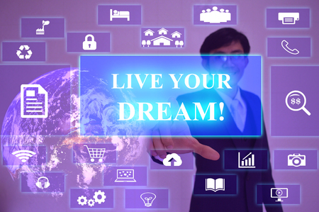 inclination: LIVE YOUR DREAM concept  presented by  businessman touching on  virtual  screen
