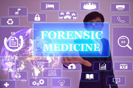 forensic medicine: FORENSIC MEDICINE concept  presented by  businessman touching on  virtual  screen