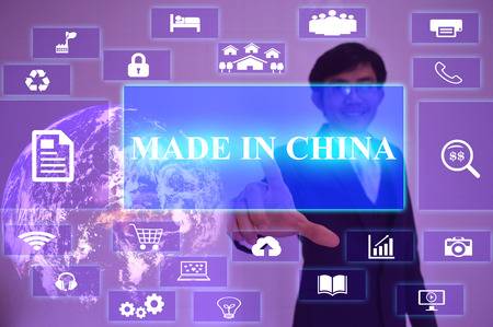 made in china: MADE IN CHINA  concept  presented by  businessman touching on  virtual  screen