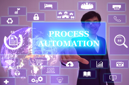 electronics industry: PROCESS AUTOMATION concept  presented by  businessman touching on  virtual  screen