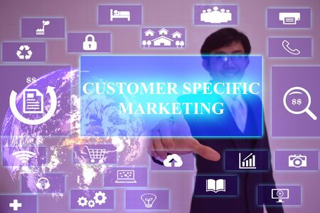 specific: CUSTOMER SPECIFIC MARKETING  concept  presented by  businessman touching on  virtual  screen