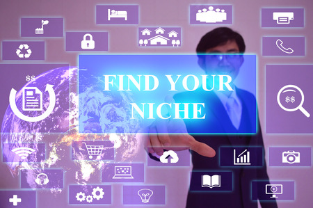 specialize: FIND YOUR NICHE concept  presented by  businessman touching on  virtual  screen Stock Photo