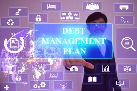 debt management: DEBT MANAGEMENT PLAN  concept  presented by  businessman touching on  virtual  screen