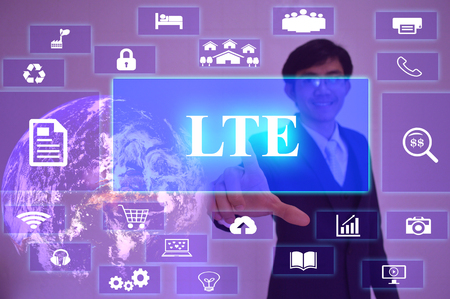 lte: LTE concept  presented by  businessman touching on  virtual  screen Stock Photo