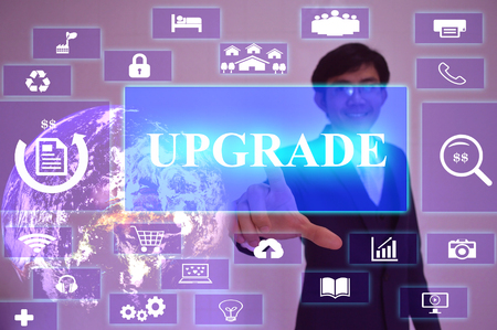 enhancement: UPGRADE concept  presented by  businessman touching on  virtual  screen ,image element furnished by NASA Stock Photo