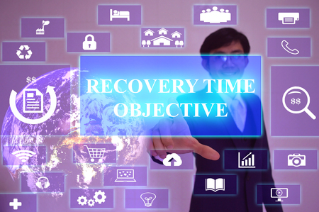 time critical: RECOVERY TIME OBJECTIVE  concept  presented by  businessman touching on  virtual  screen ,image element furnished by NASA Stock Photo