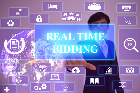 stock ticker board: Real Time Bidding concept  presented by  businessman touching on  virtual  screen ,image element furnished by NASA