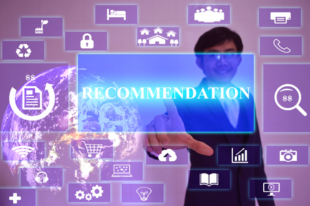 recommendation: RECOMMENDATION concept  presented by  businessman touching on  virtual  screen ,image element furnished by NASA