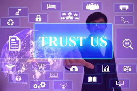 trustworthiness: TRUST US  concept  presented by  businessman touching on  virtual  screen ,image element furnished by NASA