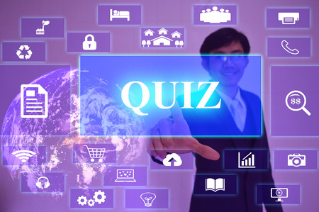 revision: QUIZ concept  presented by  businessman touching on  virtual  screen ,image element furnished by NASA