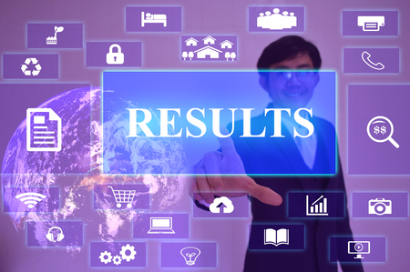 surpass: RESULTS concept  presented by  businessman touching on  virtual  screen ,image element furnished by NASA Stock Photo