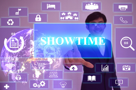 showtime: SHOWTIME  concept  presented by  businessman touching on  virtual  screen ,image element furnished by NASA