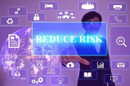 reduce risk: REDUCE RISK  concept  presented by  businessman touching on  virtual  screen ,image element furnished by NASA Stock Photo