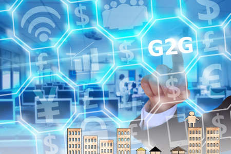 political system: businessman touching G2G or government to government on modern virtual screen Stock Photo
