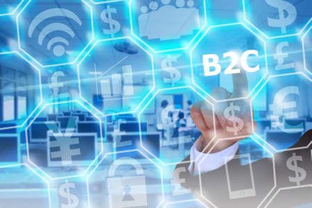 b2c: businessman touching B2C or business to consumer on modern virtual screen