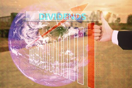 dividends: touching  dividends on virtual screen vintage tone , image element furnished by NASA Stock Photo
