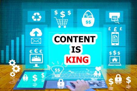 news values: technology and biz concept.select  icon CONTENT IS KING  on the virtual display Stock Photo
