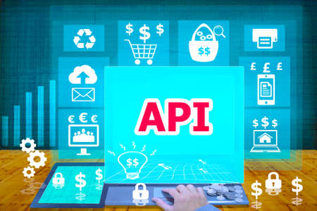 api: technology and biz concept. working on his laptop in the secured office, select  icon API   on the virtual display