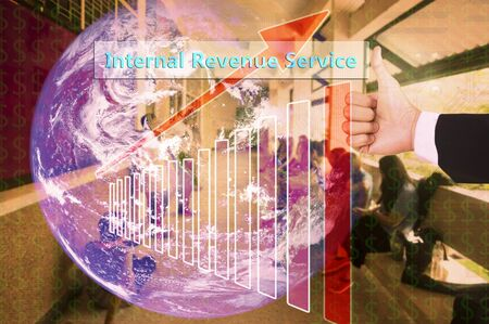 advertising revenue: touching Internal Revenue Service on virtual screen vintage tone , image element furnished by NASA