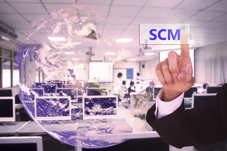 scm: touching SCM or supply chain management  on virtual screen vintage tone , image element furnished by NASA