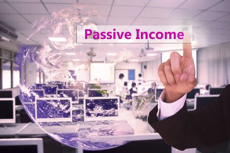 passive income: touching passive income  on virtual screen vintage tone , image element furnished by NASA