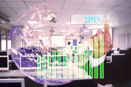 initial public offering: touching ipo or initial public offering  on virtual screen vintage tone , image element furnished by NASA