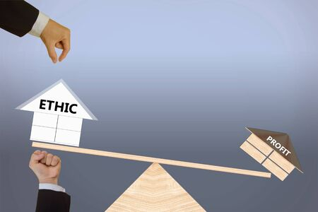 ethic: Comparing concept of ethic and profit Stock Photo