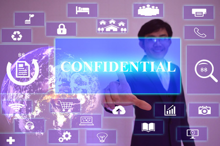 underhand: confidential concept  presented by  businessman touching on  virtual  screen ,image element furnished by NASA