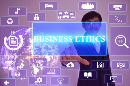 work ethic responsibilities: BUSINESS ETHICS concept  presented by  businessman touching on  virtual  screen ,image element furnished by NASA