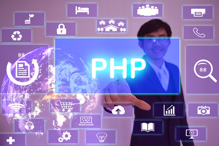 php: PHP Hypertext Preprocessor (PHP) concept  presented by  businessman touching on  virtual  screen ,image element furnished by NASA