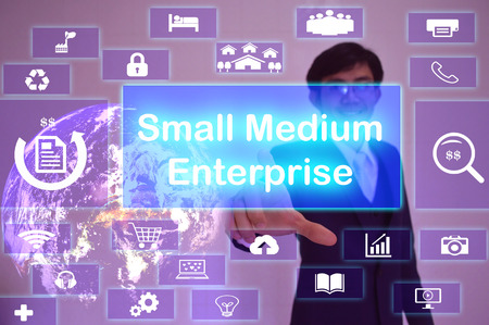 information medium: Small-Medium Enterprise (SME) concept  presented by  businessman touching on  virtual  screen