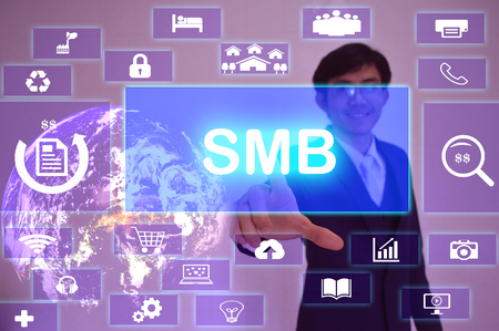 information medium: Small-Medium Business (SMB) concept  presented by  businessman touching on  virtual  screen Stock Photo