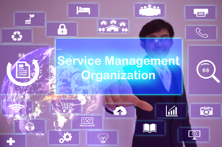 smo: Service Management Organization (SMO) concept  presented by  businessman touching on  virtual  screen