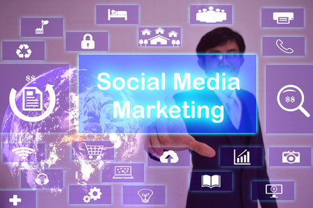 smm: Social Media Marketing (SMM) concept  presented by  businessman touching on  virtual  screen Stock Photo