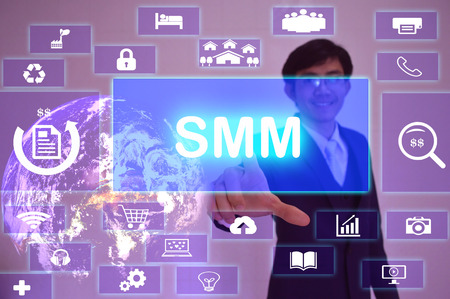 smm: Social Media Marketing(or Management) (SMM) concept  presented by  businessman touching on  virtual  screen Stock Photo