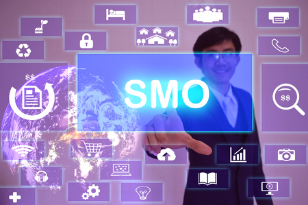 smo: Social Media Optimization or Service Management Organization (SMO) concept  presented by  businessman touching on  virtual  screen