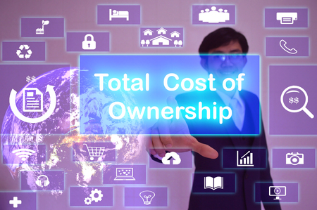 Total  Cost of Ownership (TCO) concept  presented by  businessman touching on  virtual  screen ,image element furnished by NASA Stock Photo