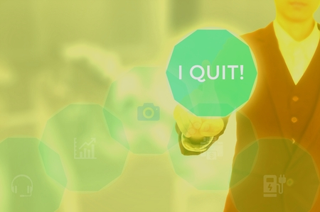 I QUIT! concept presented by businessman touching on virtual screen