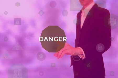 DANGER - business concept presented by businessman