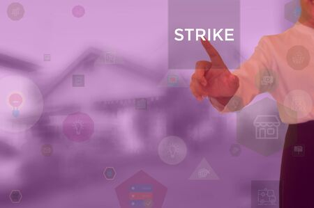 STRIKE - business concept presented by businessman
