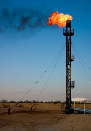 gas supply: Oil gas flare with sign