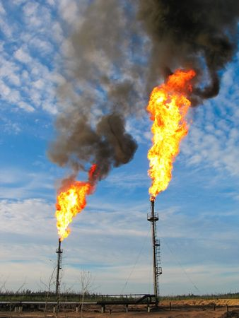 natural gas: Two gas flares burning and smoking