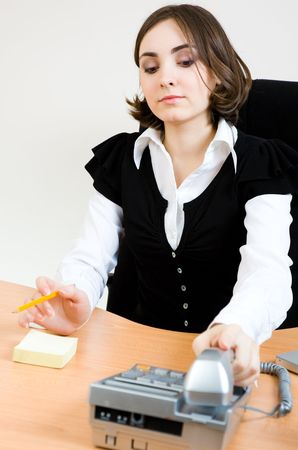 appointee: Young secretary with telephone and pencil